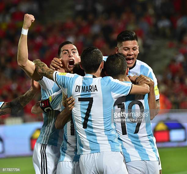 Argentina's players celebrate after teammate Gabriel Mercado scored against Chile during their Russia 2018 FIFA World Cup South American Qualifiers'...