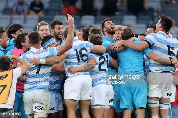 Argentina's players celebrate their victory at the end of the 2020 Tri-Nations rugby match between the New Zealand and Argentina at Bankwest Stadium...