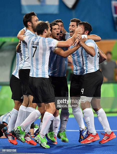 Argentina's players celebrate their victory at the end of the men's Gold medal field hockey Belgium vs Argentina match of the Rio 2016 Olympics Games...