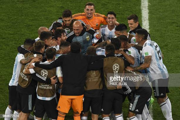 Argentina's players celebrate their win and qualification during the Russia 2018 World Cup Group D football match between Nigeria and Argentina at...