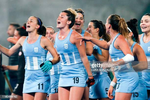 Argentina's players celebrate winning the Women's Field Hockey gold medal after defeating Canada during the Lima 2019 PanAmerican Games in Lima on...
