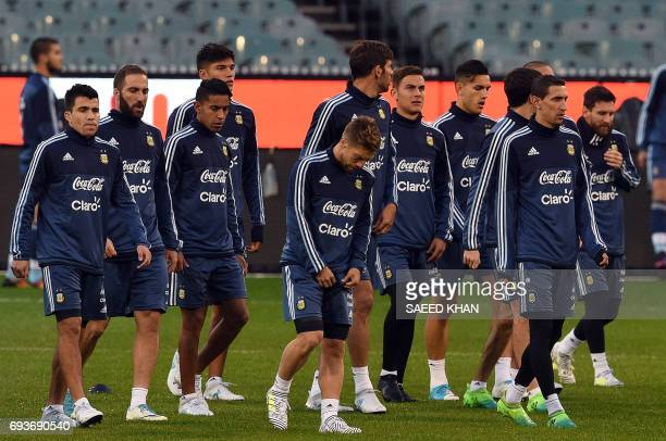 Argentina's players get ready for warmup exercises during a training session in Melbourne on June 8 ahead of their match against Brazil on June 9 /...