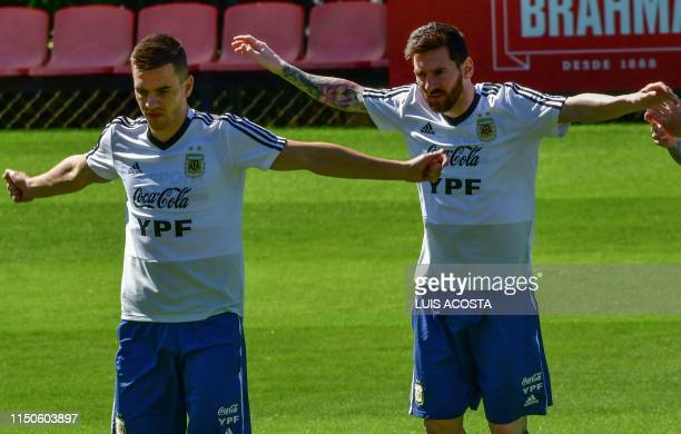 Argentina's players Giovani Lo Celso and Lionel Messi take part in a training session in Belo Horizonte state of Minas Gerais Brazil on June 18 on...