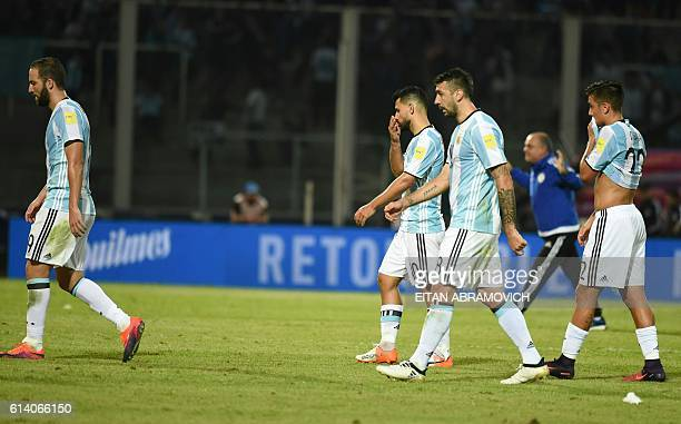 Argentina's players leave the field after the 01 Paraguay victory at the end of their Russia 2018 World Cup football qualifier match in Cordoba...