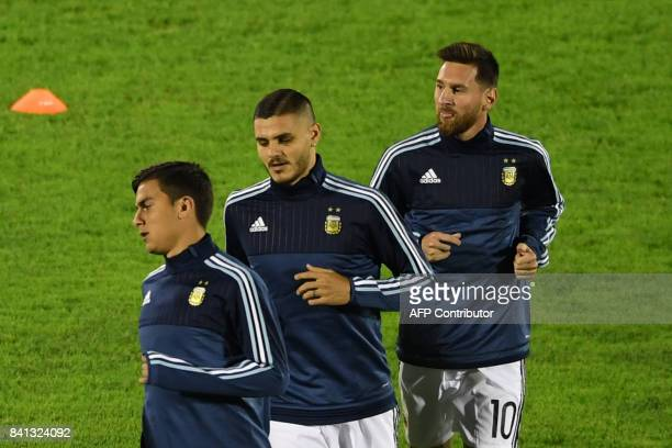 Argentina's players Paulo Dybala Mauro Icardi and Lionel Messi warmup before the start of the 2018 World Cup football qualifier match against Uruguay...