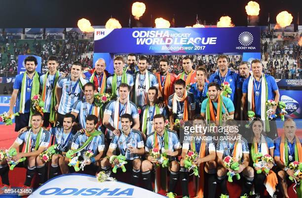 Argentina's players pose for a group picture after loosing their final match of the Hockey World League against Australia at Kalinga Stadium in...