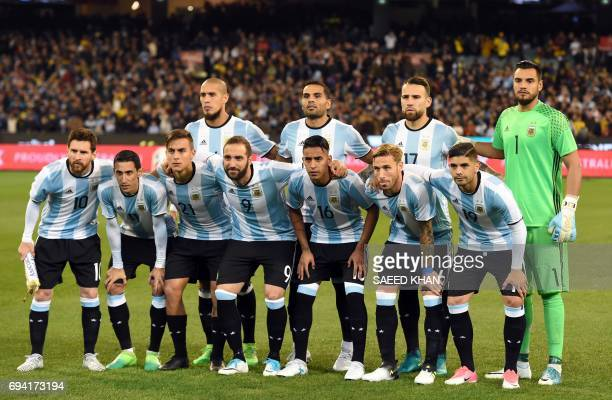 Argentina's players pose for pictures before the friendly international football match between Brazil and Argentina at the MCG in Melbourne on June 9...