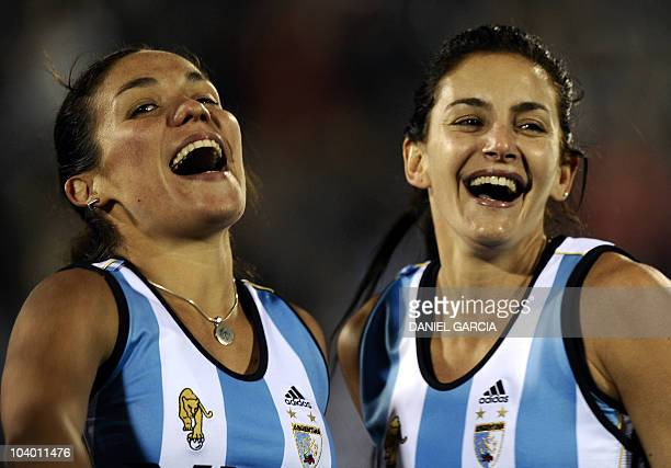Argentina's players Soledad Garcia and Luciana Aymar celebrate after defeating Netherlands 31 in the field hockey final match for the Women World Cup...