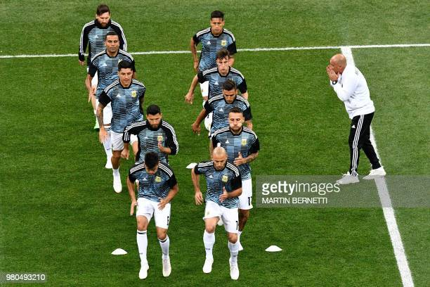TOPSHOT Argentina's players warm up before the Russia 2018 World Cup Group D football match between Argentina and Croatia at the Nizhny Novgorod...