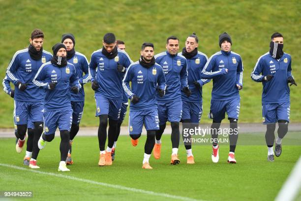 Argentina's players warmup during a team training session at the City Academy training complex in Manchester north west England on March 20 2018...