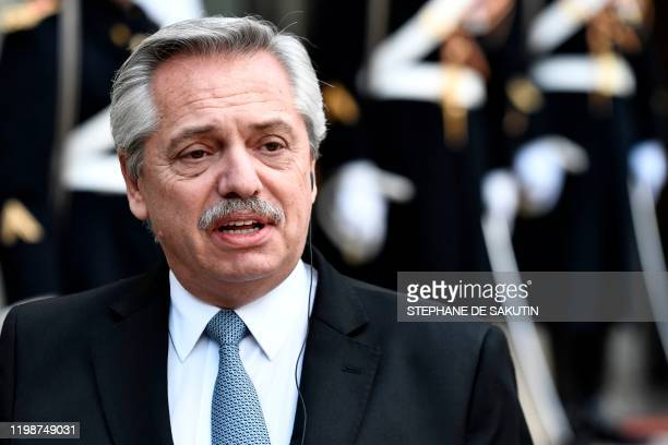 Argentina's President Alberto Fernandez looks on as he speaks to the press at the Elysee presidential Palace in Paris on February 5, 2020.