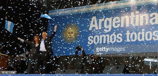 Argentina's President Cristina Fernandez de Kirchner and her husband Nestor Kirchner wave to supporters during a demonstration against the farmers'...