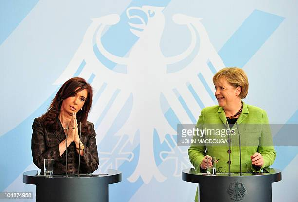 Argentina's President Cristina Fernandez de Kirchner begs a German reporter to repeat his question after she failed to understand it having taken her...