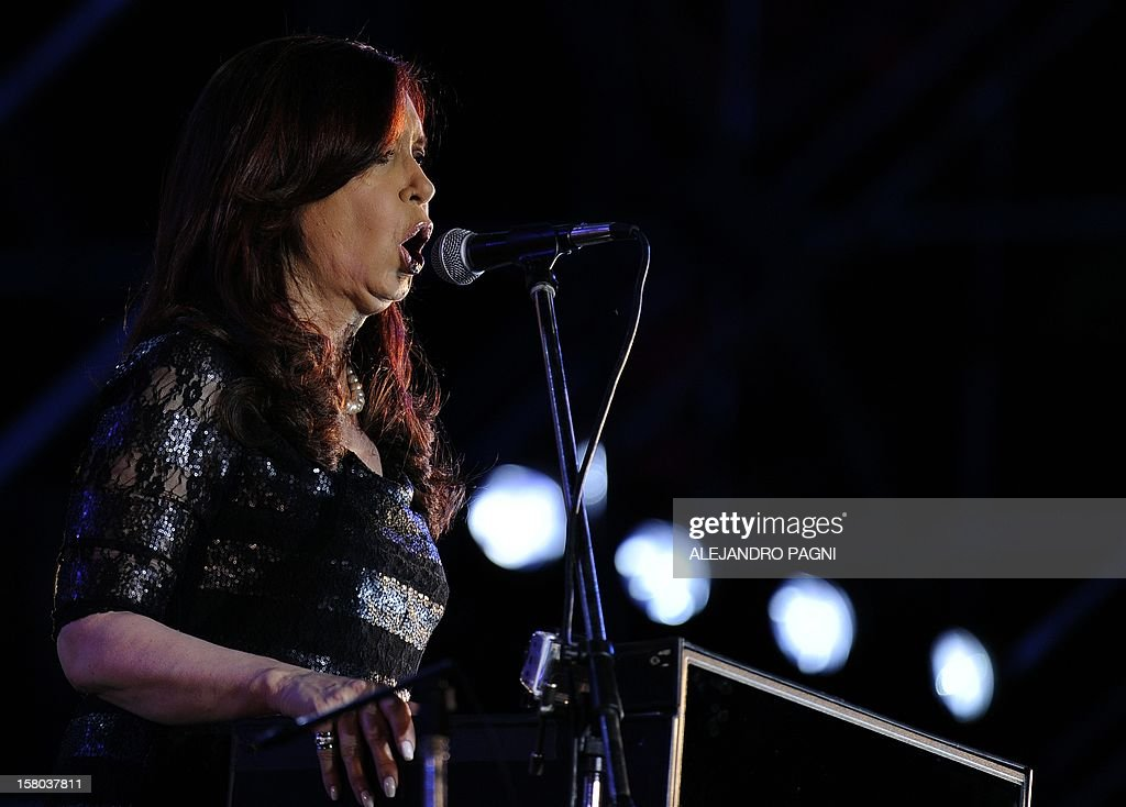 Argentina's President Cristina Fernandez de Kirchner delivers a speech at Plaza de Mayo, in Buenos Aires, on December 9, 2012, during a rally called by the government to celebrate the 29th anniversary of the return to democracy in Argentina, on the eve of the Day of Democracy and Human Rights. AFP PHOTO / Alejandro PAGNI