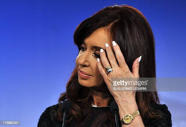 Argentina's President Cristina Fernandez de Kirchner gestures during a joint press conference with Colombian President Juan Manuel Santos at Narino...