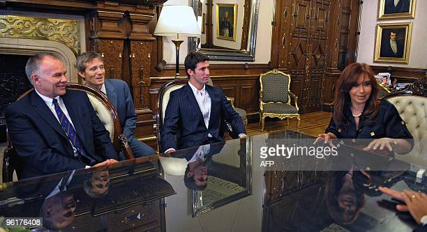 Argentina's President Cristina Fernandez de Kirchner meets with Argentinian driver Jose Maria Lopez and Sporting Director of the US F1 Team Peter...