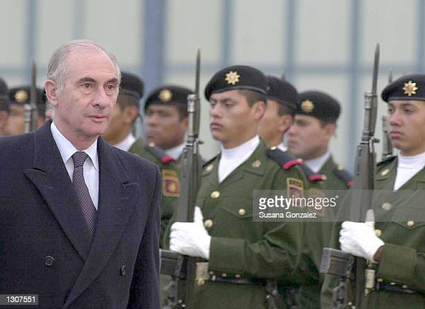 Argentina''s President Fernando de la Rua walks in front of Mexican presidential guards November 30 2000 in Mexico City He is one of the many...