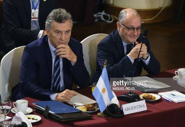 Argentina's President Mauricio Macri and his Foreign Affairs Minister Jorge Faurie attend the Mercosur President's Summit in Montevideo on December...