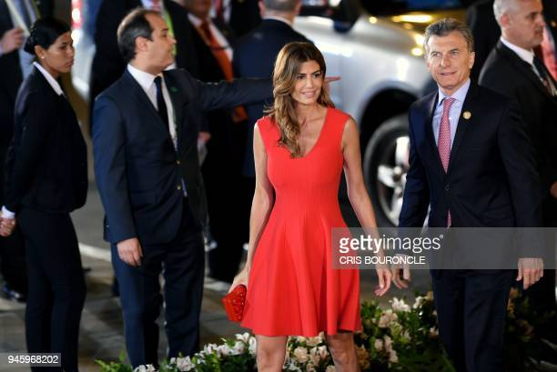 Argentina's President Mauricio Macri and his wife Juliana Awada walk upon arrival at the National Theatre in Lima to attend the Eighth Summit of the...