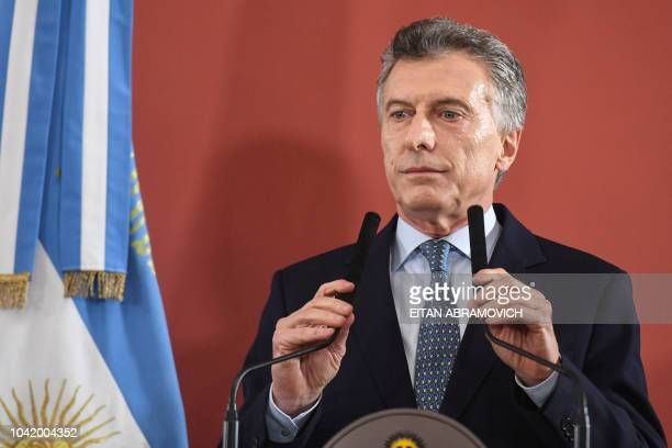 Argentina's President Mauricio Macri arrives to deliver a statement at Casa Rosada government palace in Buenos Aires on September 27 2018 Macri...