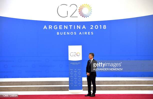 Argentina's President Mauricio Macri awaits to welcome G20 leaders at Costa Salguero in Buenos Aires during the G20 Leaders' Summit on November 30...