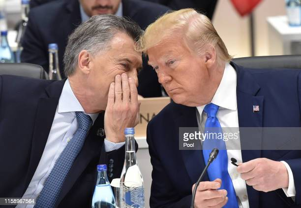 Argentina's President Mauricio Macri chats with US President Donald Trump during the session 3 on women's workforce participation, future of work,...