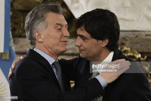Argentina's President Mauricio Macri congratulates newly appointed Argentinian Minister of Finance Hernan Lacunza during the swearing-in ceremony at...