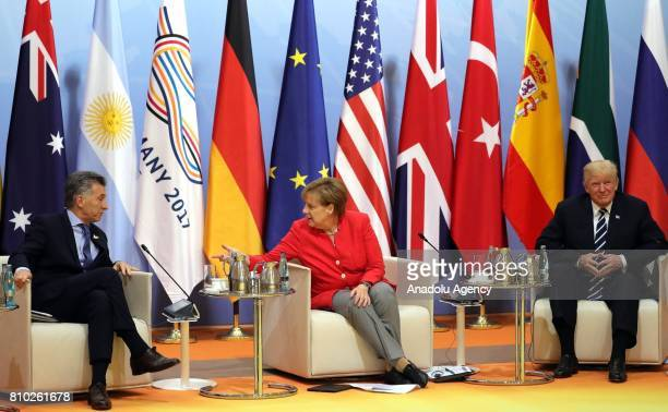 Argentina's President Mauricio Macri Germany's Chancellor Angela Merkel and US President Donald Trump attend the first meeting of G20 Leaders' Summit...