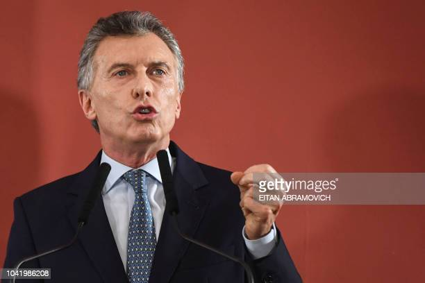 Argentina's President Mauricio Macri gestures while reading a statement at Casa Rosada government palace in Buenos Aires on September 27 2018 Macri...