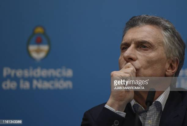 Argentina's President Mauricio Macri offers a press conference at Casa Rosada Presidential Palace in Buenos Aires on August 12, 2019 a day after...