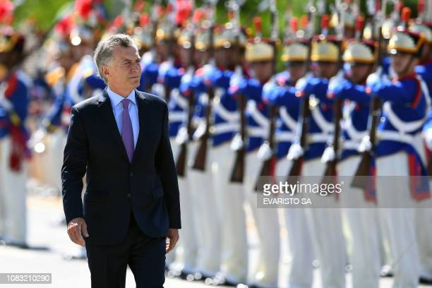 Argentina's President Mauricio Macri reviews the honor guard during his welcome ceremony at Planalto Palace in Brasilia, on January 16, 2019. - Macri...