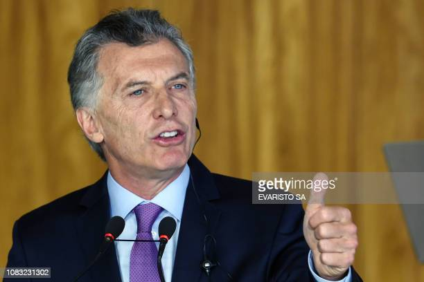 Argentina's President Mauricio Macri speaks during a joint press conference with Brazilian President Jair Bolsonaro at Planalto Palace in Brasilia,...