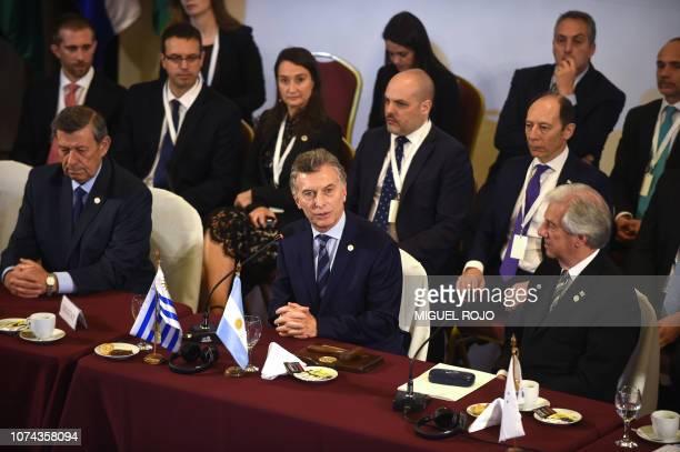 Argentina's President Mauricio Macri speaks flanked by Uruguay's President Tabare Vazquez and Uruguay's Foreign Affairs Minister Rodolfo Nin Novoa...