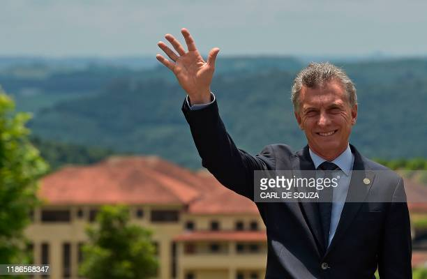 Argentina's President Mauricio Macri waves during the family picture of the 55th Mercosur summit in Bento Goncalves, Rio Grande do Sul, Brazil, on...