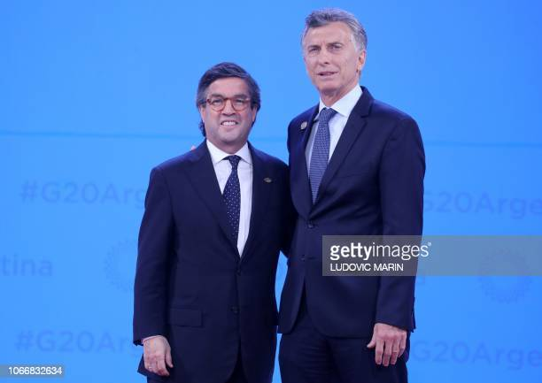 Argentina's President Mauricio Macri welcomes IDB president Luis Alberto Moreno before the G20 Leaders' Summit in Buenos Aires on November 30 2018...
