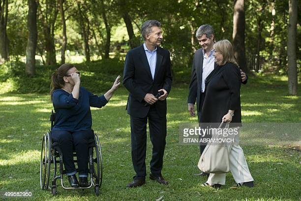 Argentina's president-elect Mauricio Macri , his appointed Chief of Cabinet Marcos Pena , vice-president-elect Gabriela Michetti and appointed...