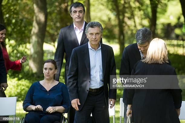Argentina's president-elect Mauricio Macri is seen next to Vice-president-elect Gabriela Michetti before during a press conference at the Botanical...
