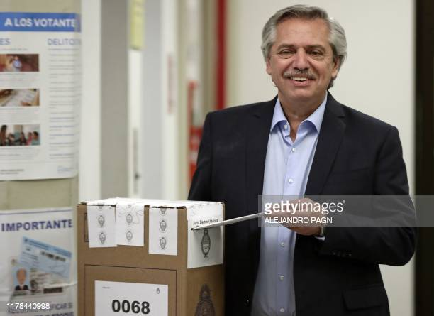Argentina's presidential candidate for the Frente de Todos party Alberto Fernandez casts his vote at a polling station in Buenos Aires during...