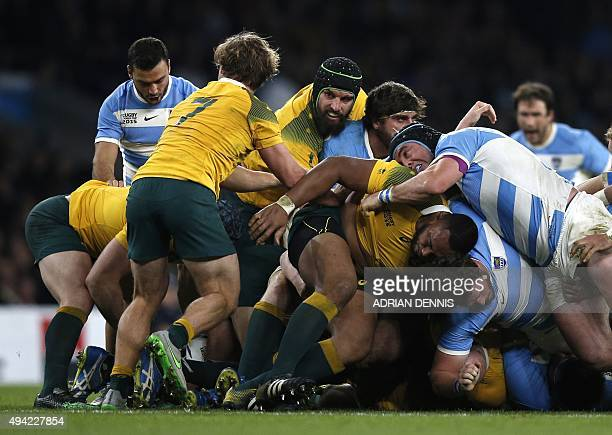 Argentina's prop Marcos Ayerza and Australia's flanker Scott Fardy vie in a ruck during a semifinal match of the 2015 Rugby World Cup between...