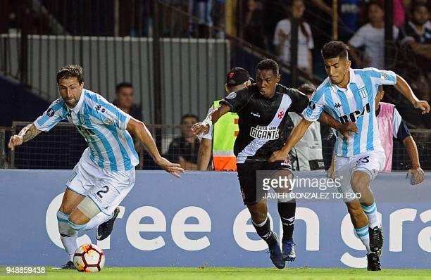 Argentina's Racing Club defender Alejandro Donatti runs with the ball pressured by Brazil's Vasco da Gama midfielder Wellington and accompanied by...