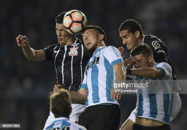 Argentina's Racing Club defender Sergio Vittor and defender Miguel Barbieri vie for the ball with Brazil's Corinthians defender Fabian Balbuena and...