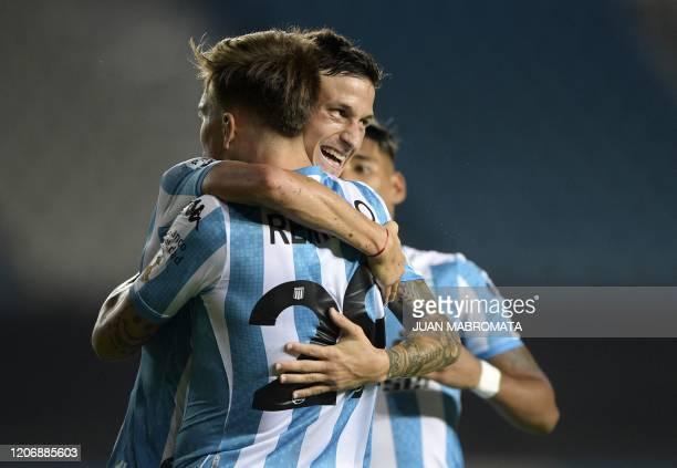 Argentina's Racing Club forward Gaston Reniero celebrates with teammate forward Hector Fertoli after scoring a goal against Peru's Alianza Lima...