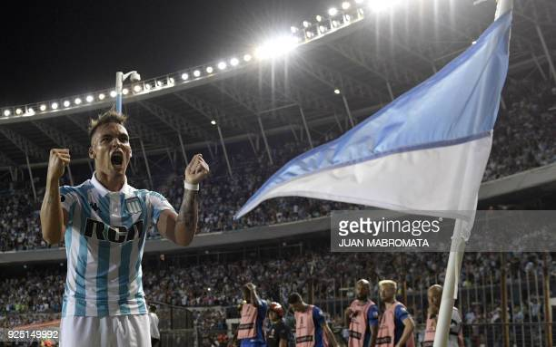Argentina's Racing Club forward Lautaro Martinez celebrates after scoring the team's third goal against Brazil's Cruzeiro during the Copa...