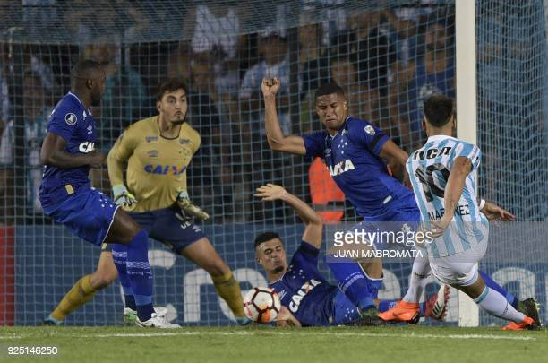 TOPSHOT Argentina's Racing Club forward Lautaro Martinez kicks to score the team's second goal against Brazil's Cruzeiro during the Copa Libertadores...