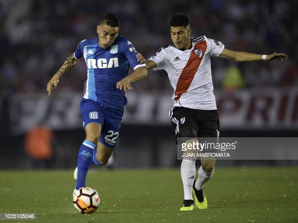 Argentina's Racing Club forward Ricardo Centurion vies for the ball with Argentina's River Plate midfielder Exequiel Palacios during their Copa...