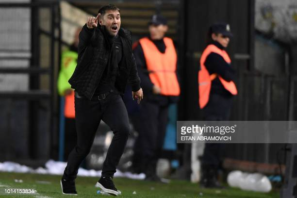 Argentina's Racing Club head coach Eduardo Coudet gestures during the Copa Libertadores 2018 round of sixteen first leg football match against...