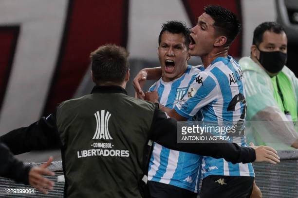 Argentina's Racing Club Leonardo Sigali celebrates after scoring against Brazil's Flamengo during their closed-door Copa Libertadores round before...