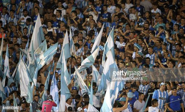 Argentina's Racing Club supporters cheer during their Copa Sudamericana football match against Colombia's Rionegro Aguilas at the Juan Domingo Peron...
