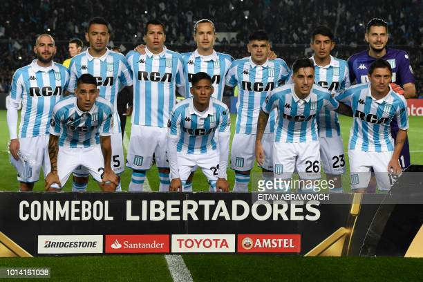 Argentina's Racing Club team poses before the start of their Copa Libertadores round of sixteen first leg football match against Argentina's River...