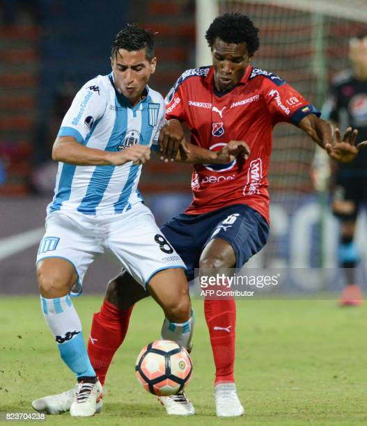 Argentina's Racing Diego Gonzalez and Colombia's Independiente Medellin Didier Moreno vie for the ball during their Copa Sudamericana football match...